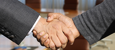 Photo of business people shaking hands.